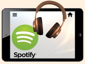 Nettbrett med Spotify på, og høretelefoner